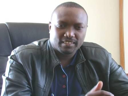 Robert   Mbui